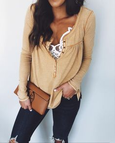 This v necked shirt emphasizes her bust and her white shirt underneath makes this look look very classy. This look is sexy but classy and can be dressed up or down.