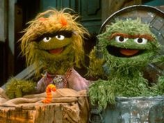 Oscar the Grouch and... is that his mother grouch or sister? Hrm...