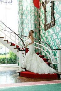 Wedding photos on the stairs of the presidential suite at the Greenbrier.