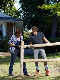 "How to Build a Simple Split-Rail Fence - Popular Mechanics - 24"" hole, two rails, one 12"" above grade."