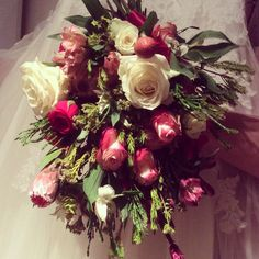 Vintage bridal bouquet in red, pink and white with plenty of natural foliage