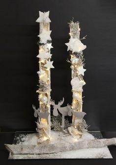 kerst - Basis halve berenklauw stengel of e.v.t een halve PVC buis deze wit verven en dan versieren met lampjes en kerstversiering