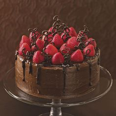 "Chocolate-Strawberry Celebration Cake Recipe -Although I have some great ""from-scratch"" recipes, this one uses a boxed mix with plenty of doctoring. It has become a popular groom's cake that gets more attention than the wedding cake. Strawberry Birthday Cake, Chocolate Strawberry Cake, Chocolate Cake Mixes, Strawberry Cakes, Chocolate Strawberries, Homemade Chocolate, Chocolate Grooms Cake, Strawberry Glaze, Chocolate Drip"