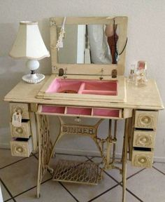Dressing table created from antique Singer sewing machine cabinet.