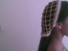 My Renaissance Reta headpiece (Italian Renaissance) that I made. It is tied loosely in the back for a 'Borgia' look. Picture was taken on an old phone that doesn't do it justice. It is made from a lovely bright metallic gold cord. Model is a family member.