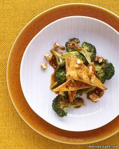 To make pan-fried tofu that's deliciously browned and crisp, first press it between weighted baking sheets for 20 minutes to squeeze out the excess liquid. Combine the tofu with stir-fried broccoli, season with soy sauce, rice vinegar, and red-pepper flakes, and top each serving with toasted cashews.