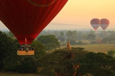 Hot air balloons floating through the sky at sunrise in Bagan. #travel #adventure #wanderlust #burma #myanmar #asia #bagan #hotairballoons #sunrise