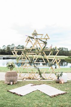 geometric inspired wedding ceremony backdrops - photo by Natalie Broach Photography http://ruffledblog.com/festive-bohemian-nye-wedding