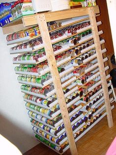 canned food storage http://recycledawblog.blogspot.com/2012/08/how-to-make-your-own-can-rotator-shelf.html