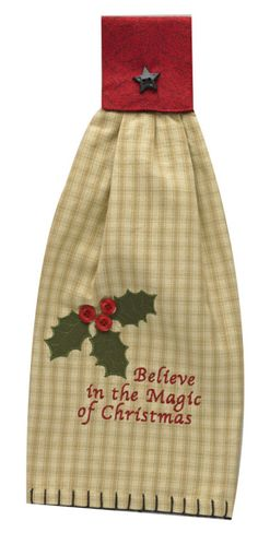 <p> Poinsettia Hand Towel, by Park Designs. Embroidery reads: Believe in the magic of Christmas. Has appliqued holly leaves and button berries. Attaches to a cupboard handle by hooking over and buttoning with the tiny star button. 100% cotton.</p>