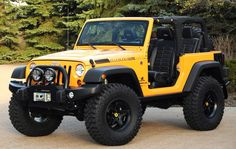 Yellow 2 door lifted rubicon Jeep Wrangler no top with a soft top option. Could do a 4 door too!