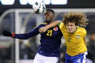 Brazil defender David Luiz, right, and Colombian forward Jackson Martinez compete during a soccer match in East Rutherford, N.J.  (Photo by Bill Kostroun / AP). First published in the November 15, 2012, 1:15 a.m. edition (http://dailysource.org/pictures/show/42578).