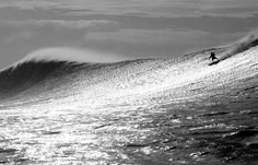 Surfing photo by Jim Russi
