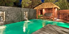L shaped pool with bali hut and feature wall water features! Great!