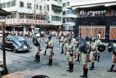 Riot police stand guard to subdue protesters in May 1967. The confrontation escalated in the second half of the year, killing and injuring both policemen and civilians.