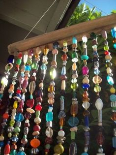 Using beads from broken necklaces to make sun catchers! Awesome idea!