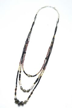 Love in lava. Layers of majestic stringed stones of lava, agates, rose quartz make this piece stand out with glam.Each of these strands features genuine stones in gorgeous hues and are studded with precious stones to complete your glam in a snap. Slip it on and get on with it. Perfect for your last minute lunch date.