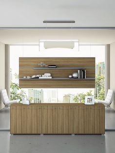 Low cupboard in Walnut canaletto and suspended tops  //  ---  //  Mobile contenitore in Noce canaletto con pannello sospeso