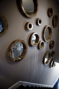 wall of mirrors going downstairs into rec room