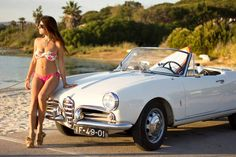 Surfer Girl with white Alfa Romeo Giulietta Veloce Spider