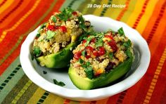 Stuffed Avocados with Quinoa - https://shrinktheplanet-weightloss.com/weightloss-diets/2016/05/stuffed-avocados-with-quinoa/