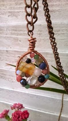 A gemstone and copper pendant!
