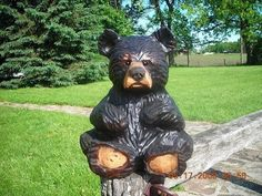 Chainsaw Carved Baby Bear Wood Sculpture.: