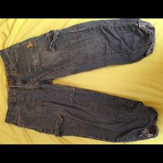 Baby PhatCapri length loose fitting jeans These cute Capri length jeans are from Baby Phat. They are pre-worn and much loved. There is some wear present. I lost a bunch of weight recently, and these are a little too big for me now Baby Phat Jeans Ankle & Cropped