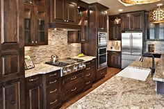 Stonehaven, Spring 2012 Parade of Homes award winner in SpurWing Greens contemporary kitchen Grand Kitchen, New Kitchen, Kitchen Dining, Kitchen Ideas, Brighton Houses, Dark Kitchen Cabinets, My Dream Home, Dream Homes, Stainless Appliances