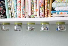 Undershlef storage using baby food jars. 10 ways to Organize Your Sewing Room | Sewing Secrets - A Blog by Coats & Clark