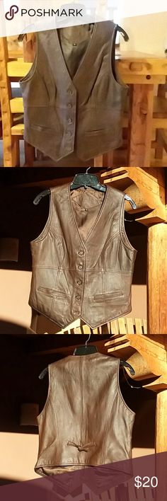 "Cabi brown leather vest Butter soft, chocolate brown leather vest.  Like new condition.  Two front pockets.  Measures 18"" across armpit seam to armpit seam and 23"" from top of shoulder to point at bottom of vest.  This is a fun piece to mix and match with lots of outfits!  Make me an offer! CAbi Jackets & Coats Vests"