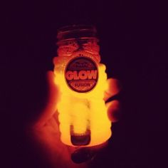 Breaking a glow stick into a bubble container = Glow in the dark bubbles!  I'm taking this idea on camping trips