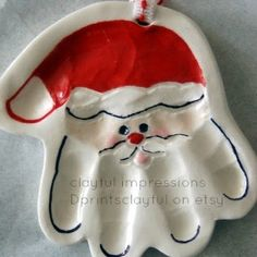 Happy-Go-Lucky: Santa Handprint Ornament - made using your childs (or anyone elses) handprint! too cute!