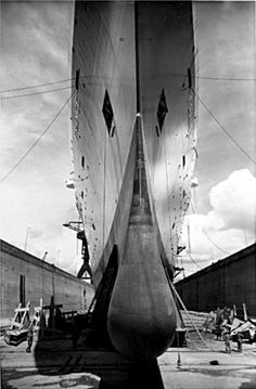 The bulbous bow, and knife-like prow, of the France, last great flagship of The French Line. Le Havre, date unknown.