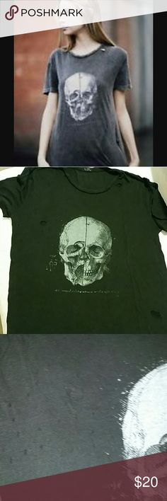 John Galt Distressed Skull Tshirt NWOT READ: Never worn john galt, one size, oversized skull tshirt. Distressed with HOLES! Washed/faded black fabric, super soft. Purchased from Brandy Melville a couple years ago. Brandy Melville Tops