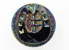 """An antique black glass button with iridescent luster and a polished horseshoe design. It measures just over 7/8"""" (NBS medium) and is in good condition with some tiny nicks and other signs of wear. Please note that the pictures are greatly enlarged, so any imperfection looks like damage, but this button looks great in person."""