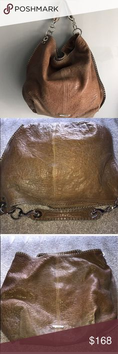 Rebecca Minkoff great Hobo LARGE Bag Rebecca Minkoff LARGE Bag. This bag has been very pre-loved. But still has a lot of love to give. It has its flaws but still has its beauty. Needs a little bath.  Perfect for someone on the go who needs a really large sturdy comfortable quality bag. Brown/Silver Rebecca Minkoff Bags