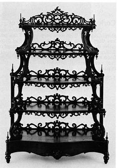 sexy black gothic bookcase..... I'd put in my bedroom with all the things I would need to get ready...jewelry etc.