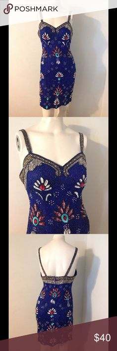 "Vintage Blue a Floral Sequin Beaded Fitted Dress S Very pretty vintage dress. Blue with sequins, pearls and beads. Great condition. Seems to fit a size small. Chest 34"" Waist 27"" Hips 35"" Vintage Dresses"