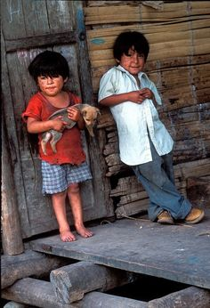 Mestizo boys with their dog living by the side of the trans-amazonica highway, Ecuador by Terry Button. Digitized Fuji Velvia film.