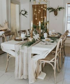 Winter Holiday Tablescape Photographers : Jessica Weiser and Lyle Koehnlein Read More on SMP: http://www.stylemepretty.com/living/2016/12/21/a-nordic-inspired-holiday-gathering/