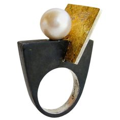 View this item and discover similar for sale at - A blackened sterling silver and pearl ring by Heidi Abrahamson of Phoenix, Arizona. Ring features a slanted panel of gold leafed sterling silver to highlight Contemporary Jewellery, Modern Jewelry, Jewelry Art, Gold Jewelry, Jewelry Rings, Jewelry Center, Glass Jewelry, Pearl Jewelry, Fine Jewelry