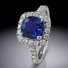 Sapphire and diamond halo ring by Simon Wright