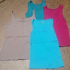 Tank Top Bundle This is for 4 tank tops. I will not seperate. Lighter blue, brand: Faded Glory, size M, 100% Cotton. Blue green color, brand: Old Navy, size M, 100% Cotton. Pink tank, brand: Old Navy, size M, 100% Cotton. Tank with gold accents tank is brand new, brand: NY&C size L. 95% Cotton, 5% Spandex. No rips, tears, flaws, or defects. Comes from a smoke free home. Final price unless bundled. No trades,  no holds, thank you. Tops Tank Tops