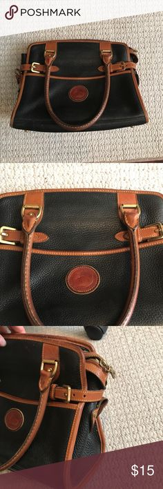 Dooney & Burke Tan and Black Small Purse Has been used, can tell from the handles. It is authentic, spelling it since I rarely use it. Dooney & Bourke Bags Mini Bags