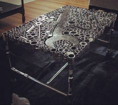 Cool idea for a man cave/coffee table made from tools/car parts