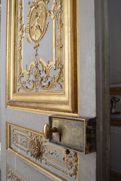 Rustic gold, grey and brass details at the chateau de Versailles.