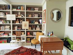One Room, Four Uses - Genevieve Gorder's Best Designs on HGTV. Love the bookshelves with the contrasting color behind. 7-20-13.