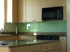 Glass backsplash made from As-Is doors from Ikea?  You had me at EASY TO CLEAN. I think in order to get him to love it, I'll have to show him the espresso build-up on one of our kitchen walls.  http://www.ikeahackers.net/2011/01/back-painted-glass-backsplash.html?utm_source=feedburner&utm_medium=feed&utm_campaign=Feed%3A+Ikeahacker+%28ikeahacker%29