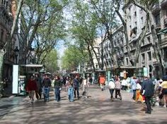 Walking down Las Ramblas A main thoroughfare through Barcelona, it's mostly for foot traffic. The tree-lined center is completely open with shops, cafes, and restaurants. Two tiny lanes on each site of the wide center walkway are used for auto traffic. Barcelona Las Ramblas, Barcelona Catalonia, Valencia, Travel Memories, Im In Love, Places Ive Been, Cruise, Walking, Street View